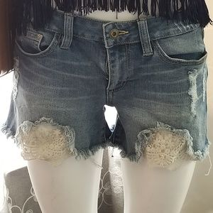 SNEAK PEAK  DISTRESSED LACE DENIM SHORTS